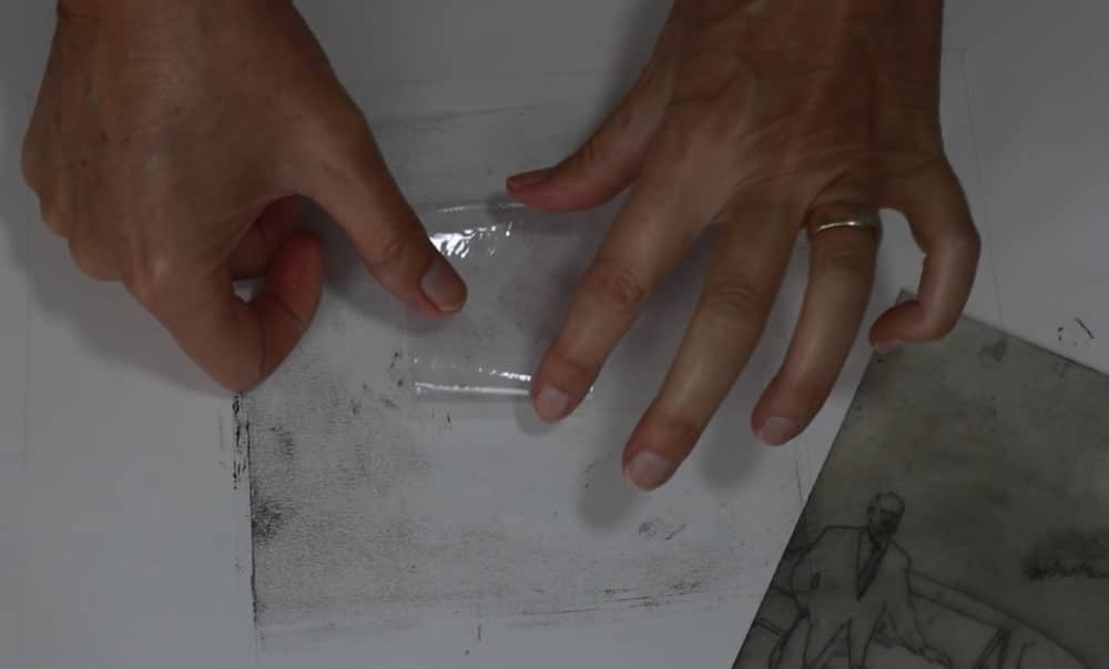 Taping the Drypoint plate to a surface will help stabilize it for hand transfer with a spoon