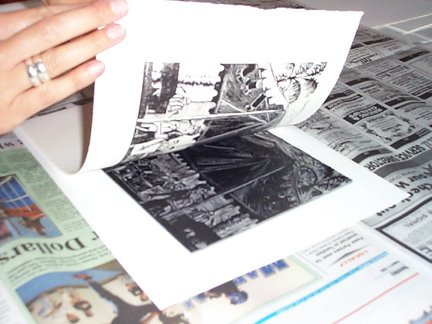 pulling a linocut print after transferring the ink from the block to the paper
