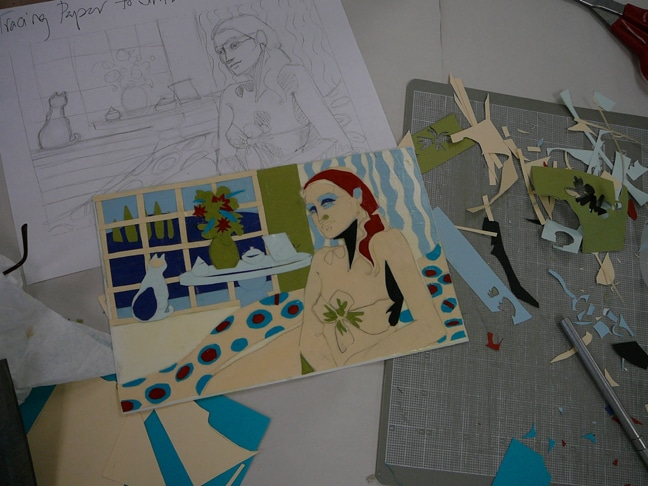 More paper cutouts on construction paper, layered on a piece of mat board in the shape of a reclining woman and a cat in the window