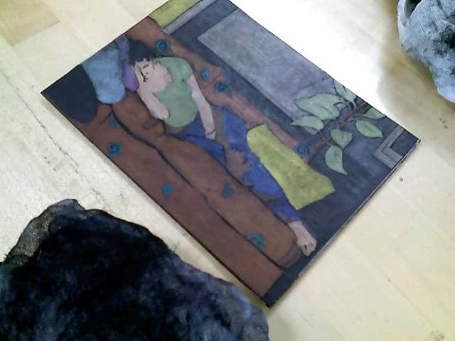 after inking and wiping a collagraph plate, a thin veil of black ink is visible over all the construction paper shapes