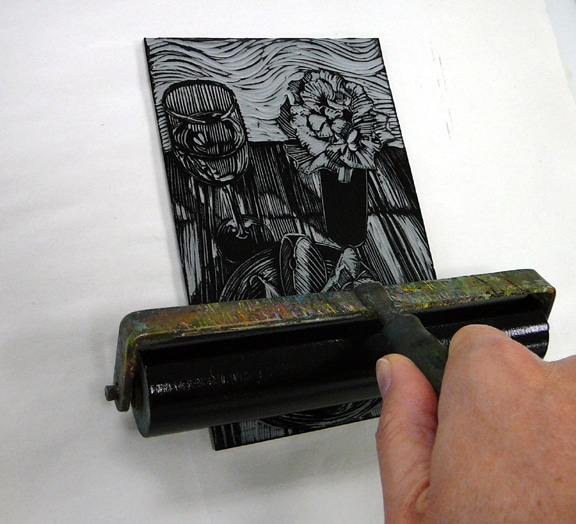 linocut printmaking and rolling ink out on the carved block