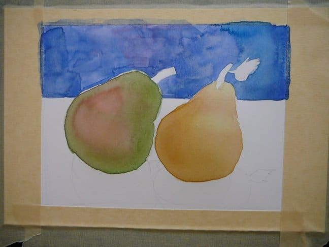 the beginnings of a pear still life in watercolor