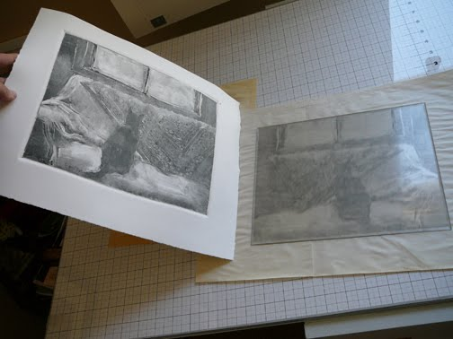 pulling a dark field monotype print of a cat on a couch staring out the window