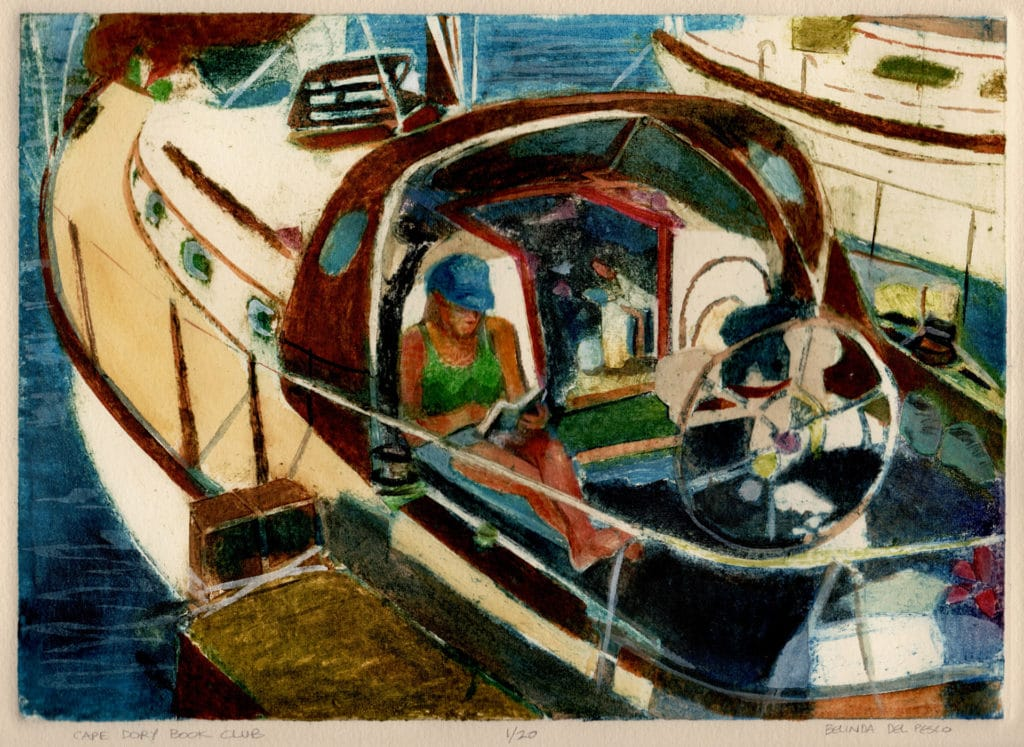 a collagraph print of a cape dory sailboat with a woman in the cockpit reading a book