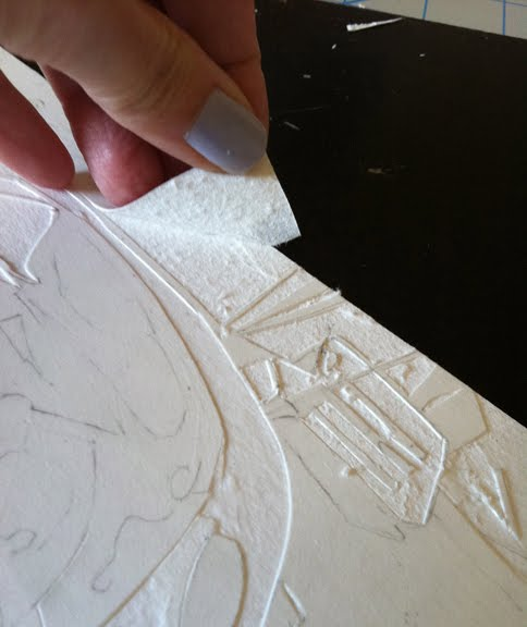 peeling the uppermost layer from a sheet of mat board to create a collagraph print