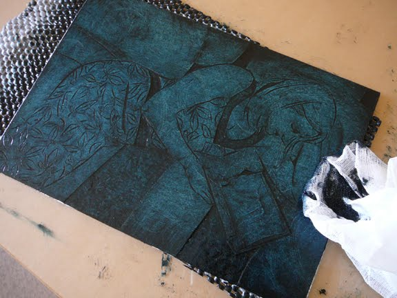 a figurative collagraph print getting inked and ready to print