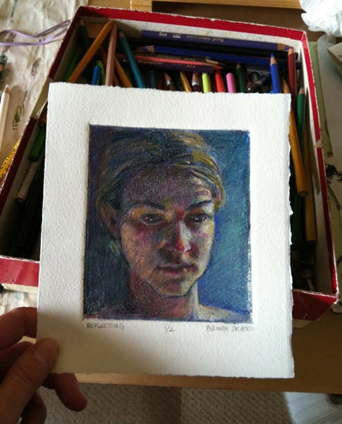 a silk aquatint portrait with colored pencil added to the print