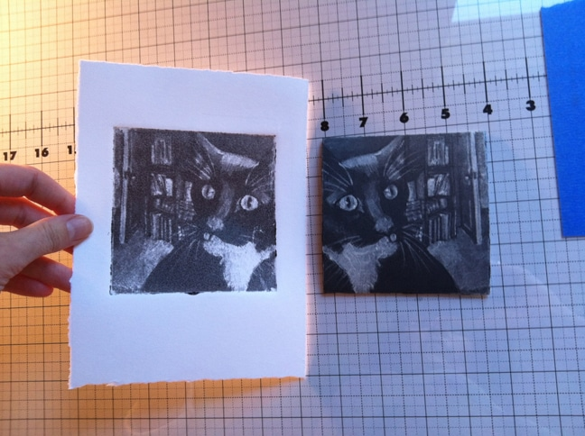 silk aquatint print of a cat being pulled from the plate