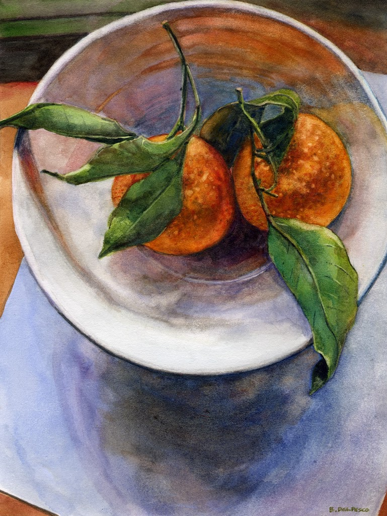 a view from up above, looking down on a white bowl with two clementines with their stems and leaves intertwined