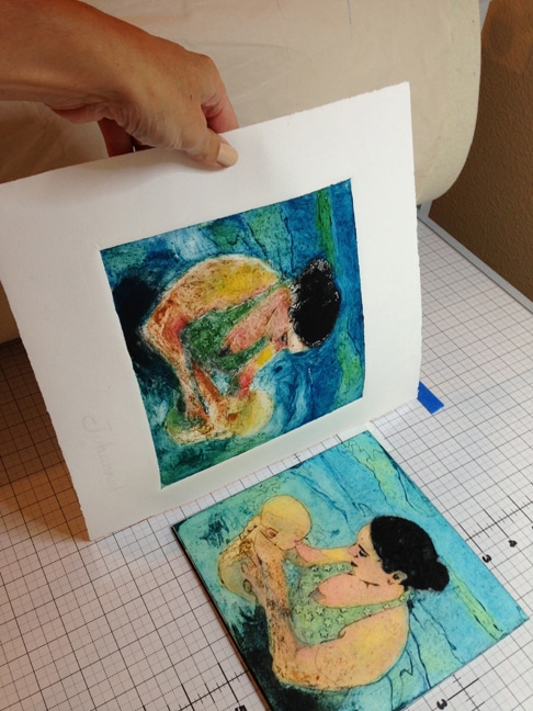 a collagraph print of a woman teaching a baby to swim