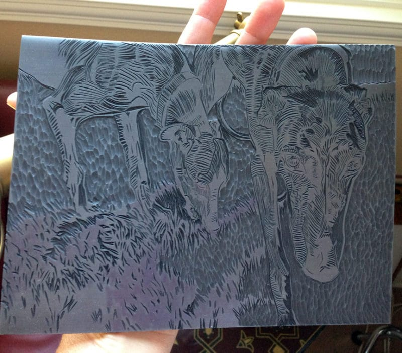 carving a linocut of dogs