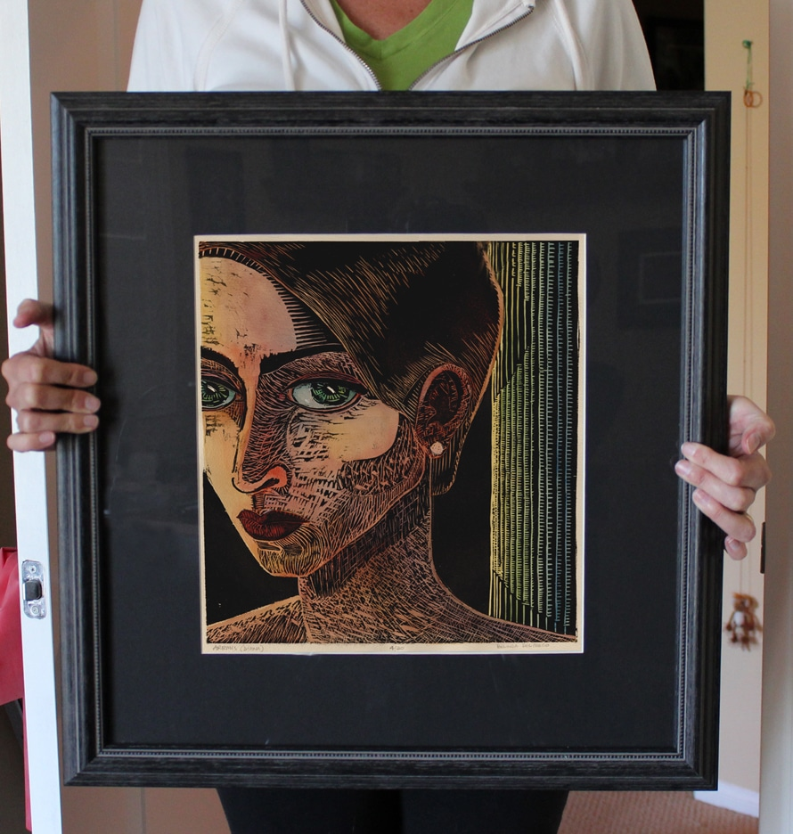 a woodcut of the greek goddess Artemis (or Diana) painted with watercolor and framed
