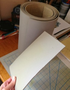 cutting a sheet of linoleum from a long roll of the stuff