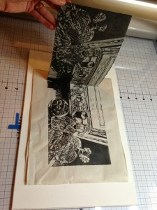 pulling a test print on newsprint for a linocut