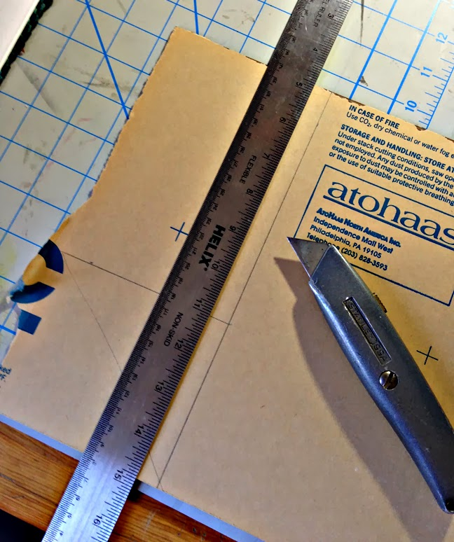 cutting plexiglass into smaller sizes for printmaking projects
