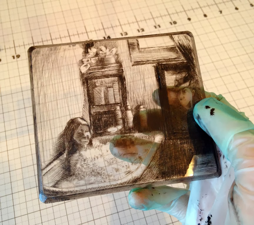 after inking and wiping a sheet of engraved plexiglass, it's ready to test print