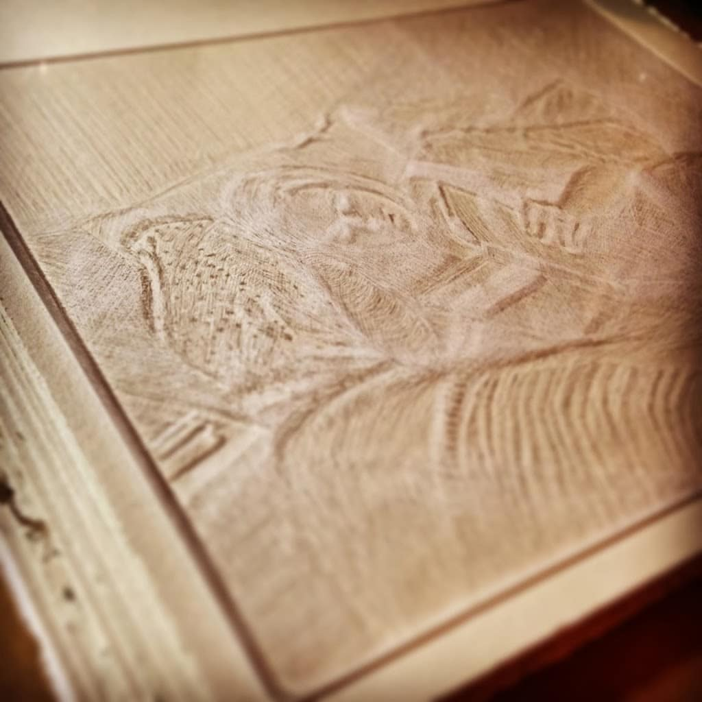 a drypoint engraving on plexiglass of a girl reading a book