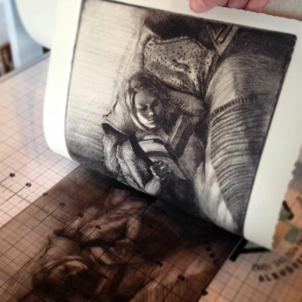 a close up of a drypoint etching being pilled from a plexiglass plate