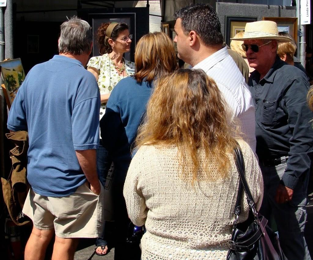 Belinda Del Pesco talking to patrons at an art fair
