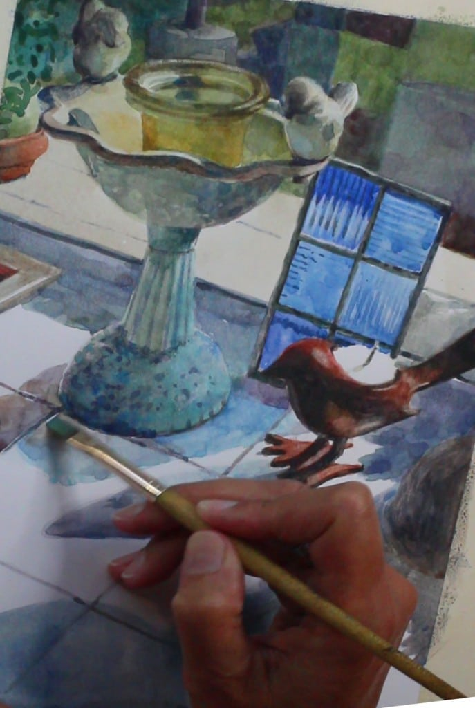 painting a watercolor of sunlit glass reflections on a kitchen counter