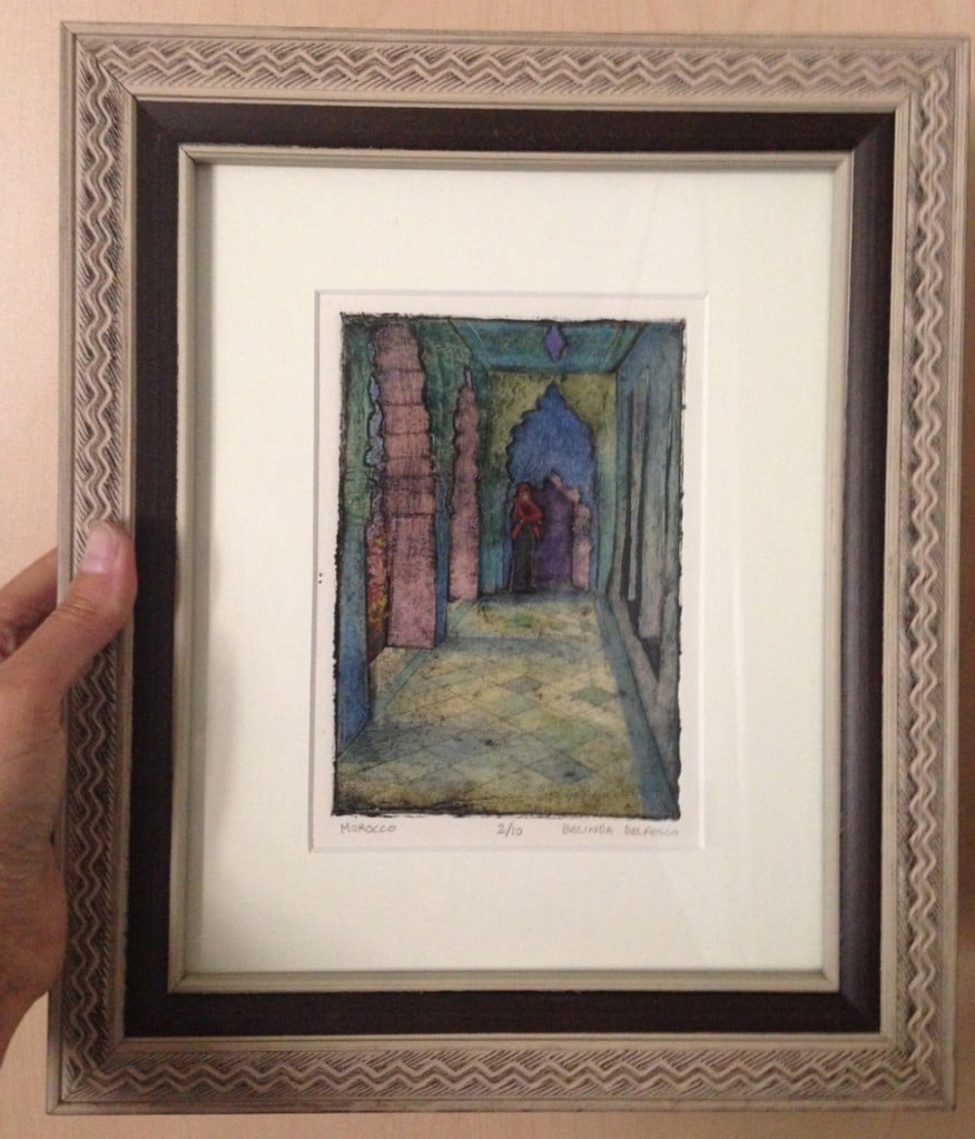 a framed collagraph print with watercolor, showing a moroccan arcade