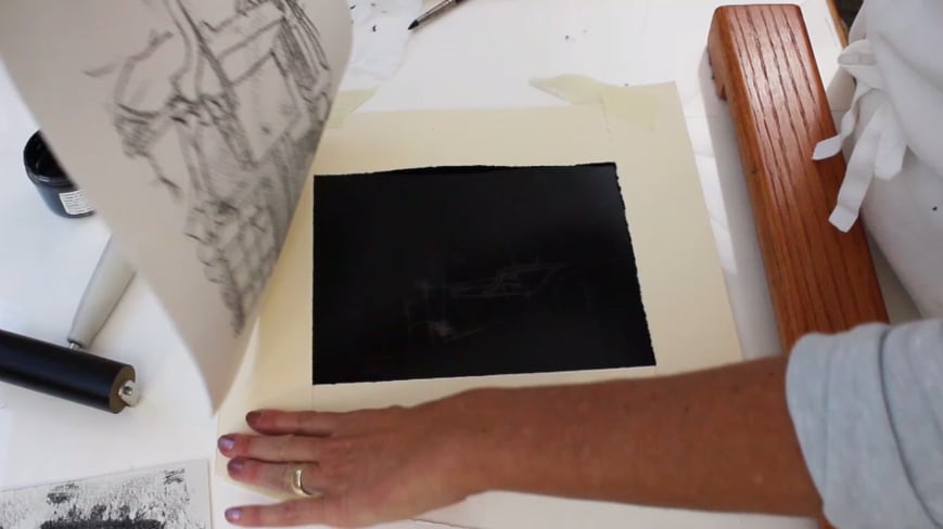 pulling the monoprint from the wet ink for a trace monotype