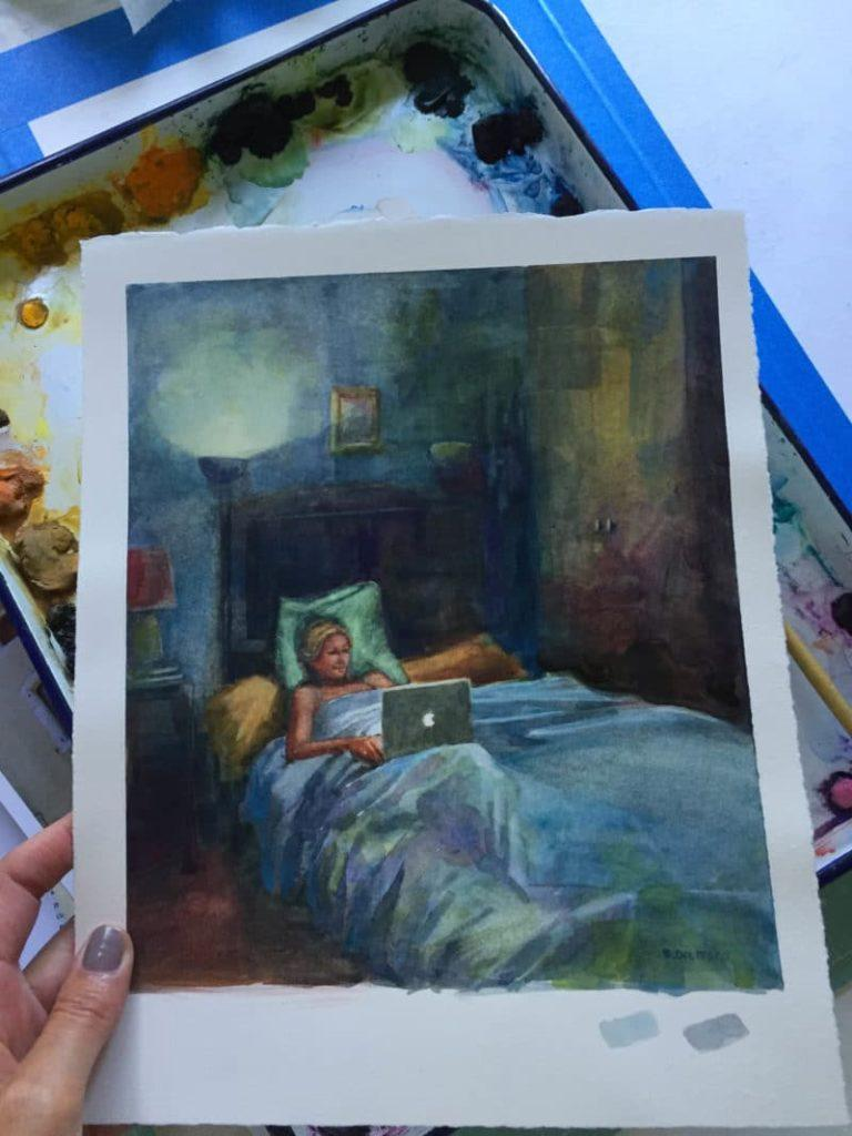 a woman in bed looking at her laptop