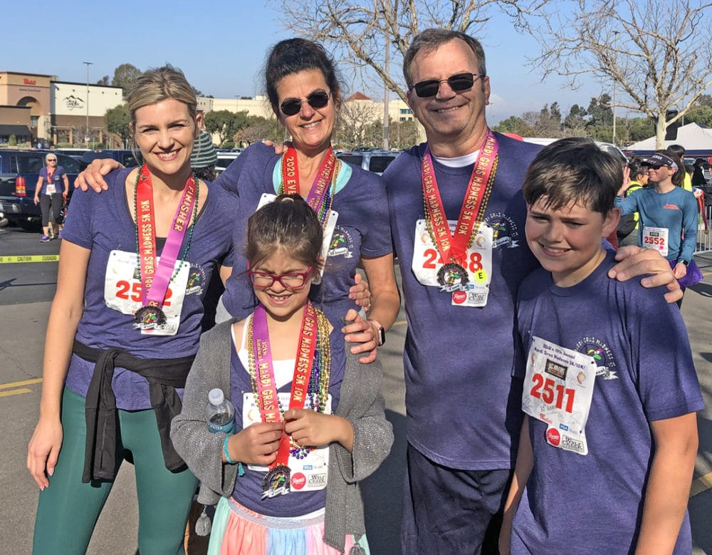A family of smiling adults and kids after a 5K race in Santa Clarita