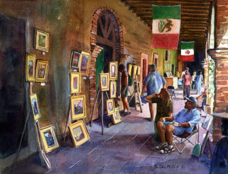 a painter displaying his oil painting in an arcade at the San Juan Capistrano Mission