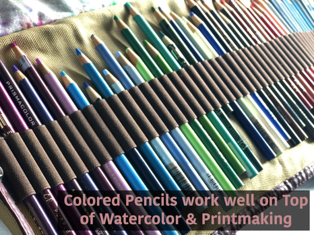 A canvas roll of colored pencils held by elastic straps so the entire set of pencils can be rolled up and taken to draw outdoors, or in various locations.
