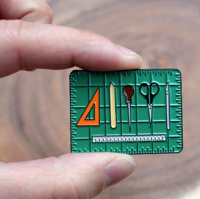 an artists or crafter's lapel pin as a gift idea