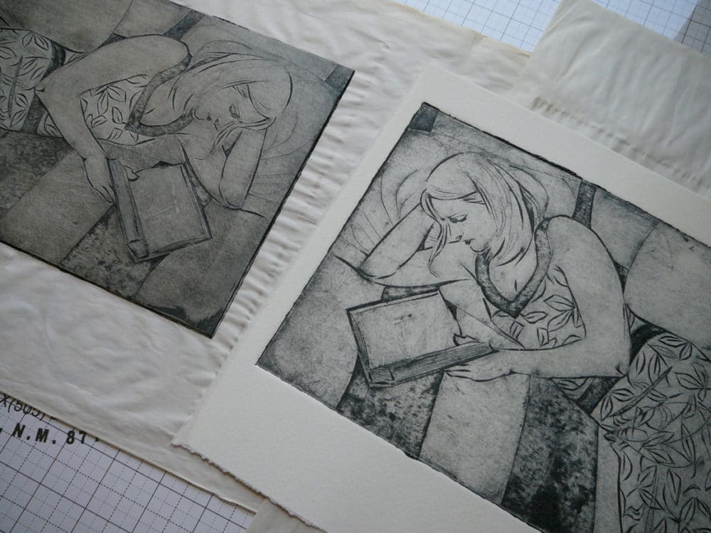 a figurative collagraph plate next to the resulting collagraph print