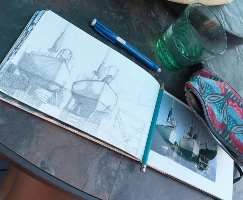 Sketching in pencil outdoors, from a photo snapped at a boat yard
