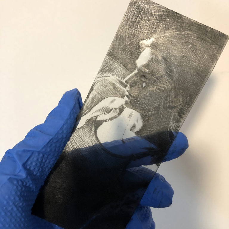 drypoint etching of a woman in profile