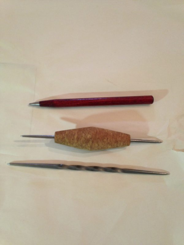 Three etching tools - a diamond tipped scribe, a cork handled scribe and a twisted scribe - also called a Whistler's Needle