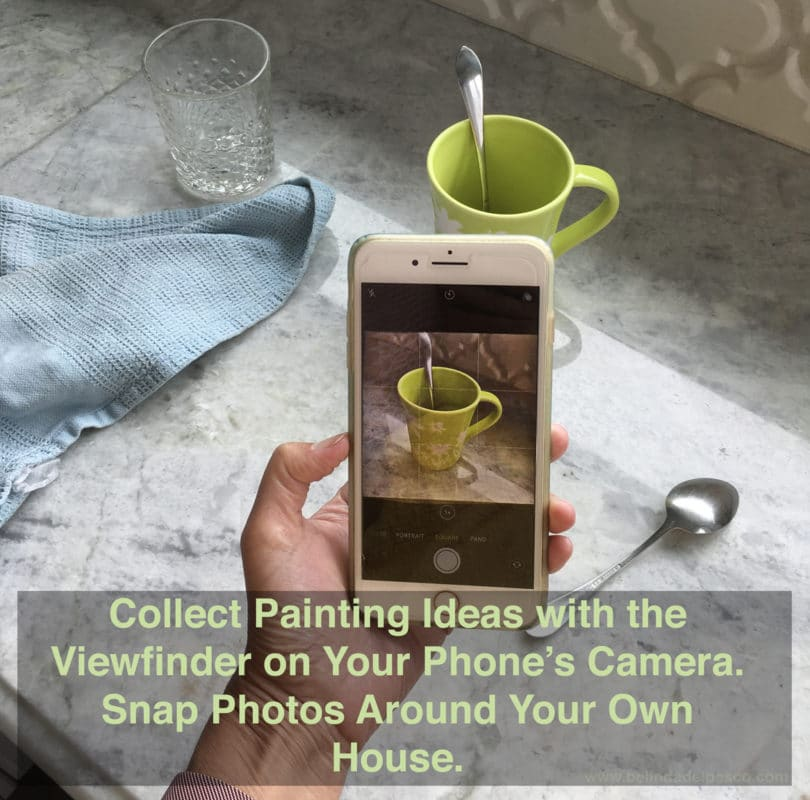 a cell phone camera is used to crop a kitchen mess, and focus on a single cup casting a shadow