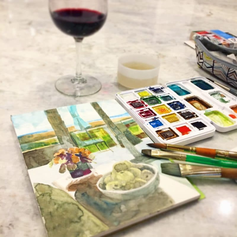 Painting small watercolor after dinner