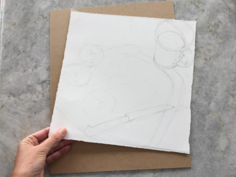 a sheet of watercolor paper is laid on a board with a light pencils sketch, ready to be taped down as preparation for a watercolor painting