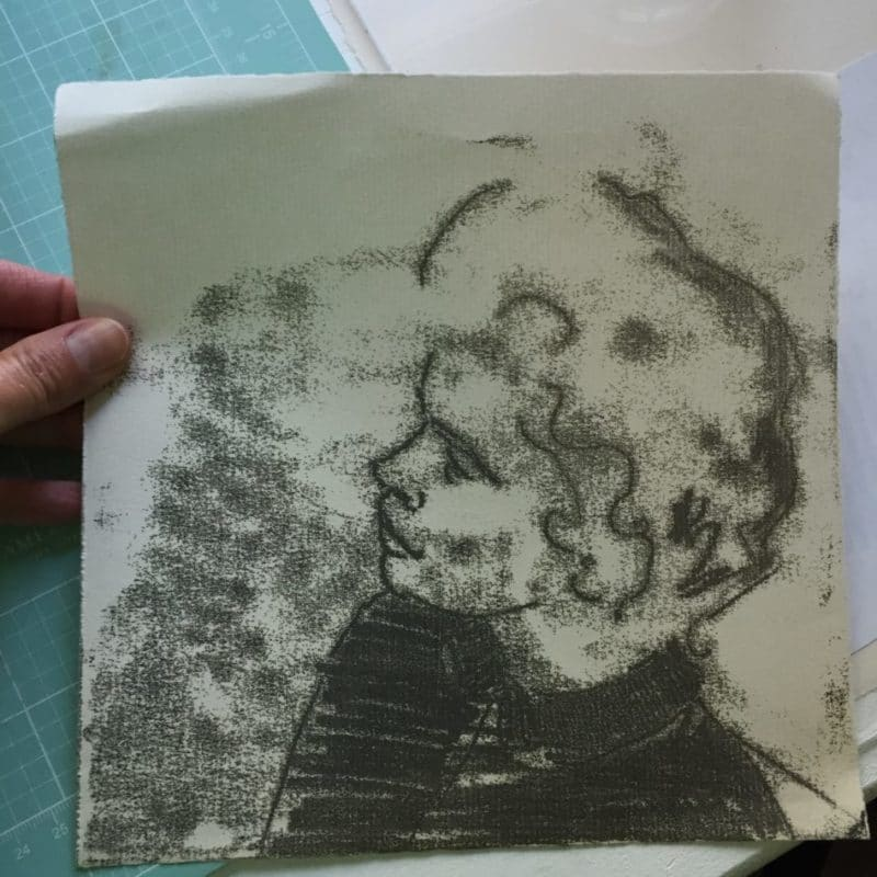 a sketchy black ink trace monotype print of a profile of a woman with cropped hair