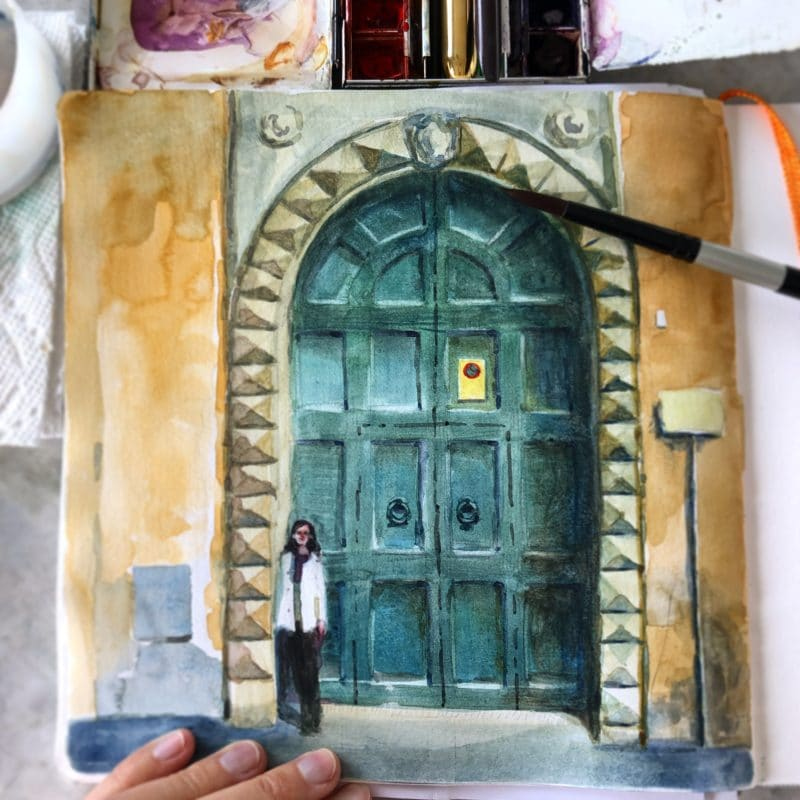 a watercolor sketch of a figure in front of a huge green door in Florence, Italy