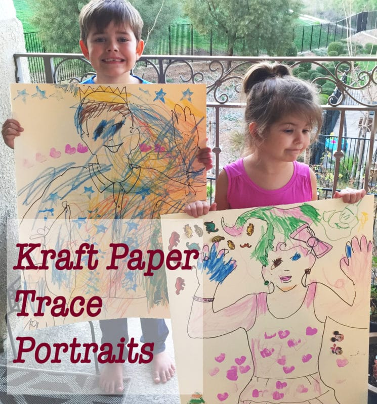 Kraft Paper Trace Portraits held proudly by two little artists