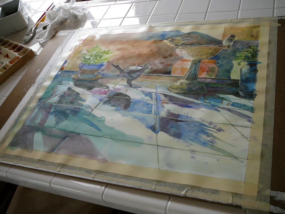 a watercolor painting of flowers on a kitchen counter in process