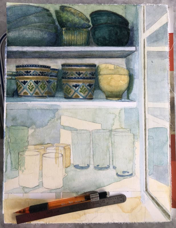 a still life watercolor in process, showing the bowls and cups and glasses in a kitchen pantry, with a pencil and ruler laying on the paper, indicating that adjustments had to be made to the painting while it's underway