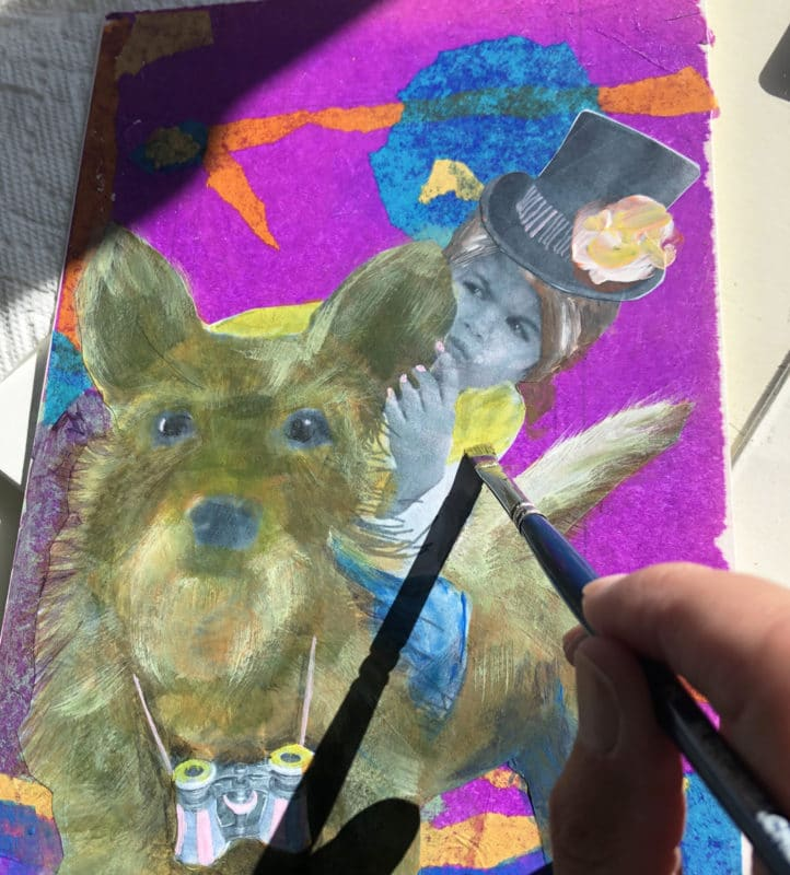painting a printer paper photo collage with acrylic paint