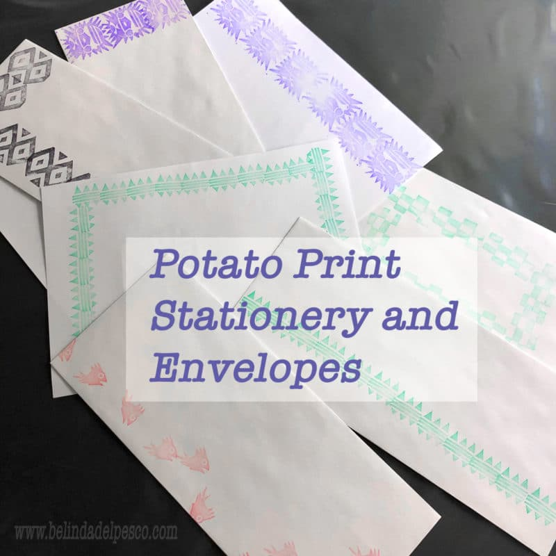 Sheets of paper and enveloped with repeated designs stamped across the top or around the border in purple or green ink, from impressions made with potato prints