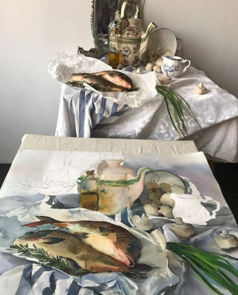 Tamara-Kamaeva still life in watercolor pf pottery, platters, olive oil, scallions and fish