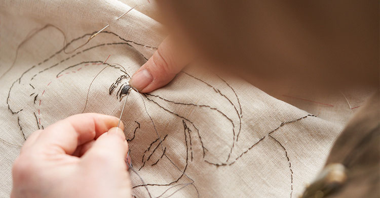embroidery floss stitching of family portraits