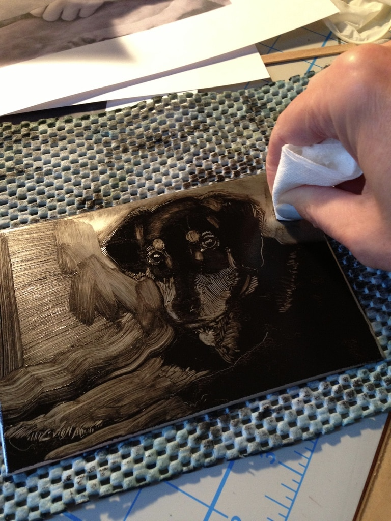 a dark field monotype of a puppy in process