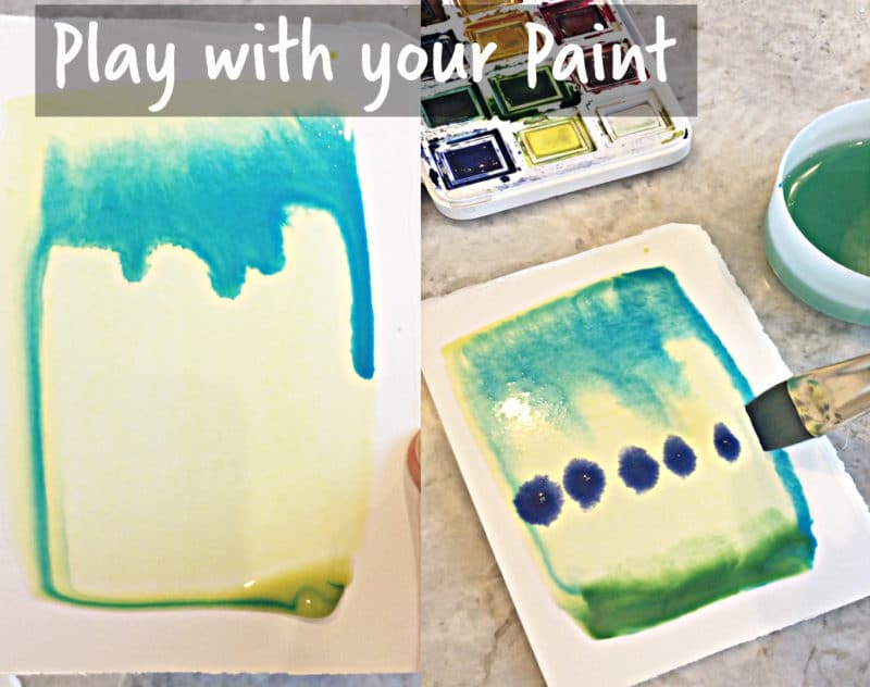 watercolors being dropped next to each other on wet paper to spread and migle into new colors