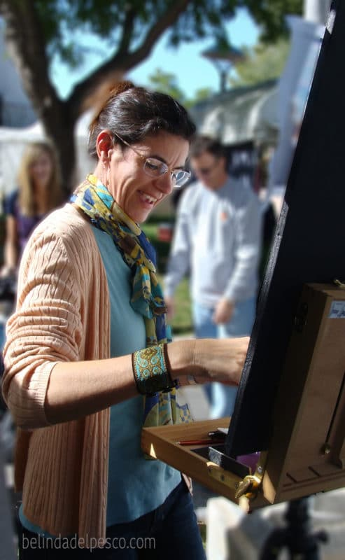 Belinda Del Pesco painting a watercolor at an art festival